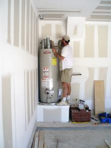 one of our Bakersfield plumbers is fixing a water heater